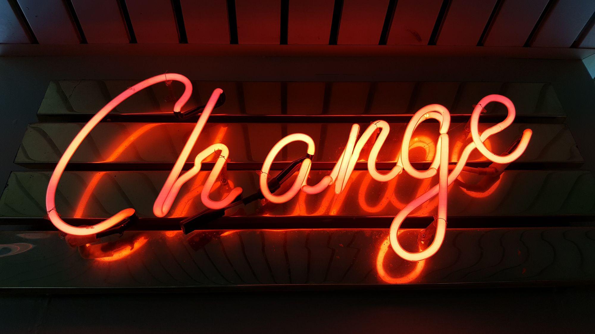 "A neon sign reading ""change."""